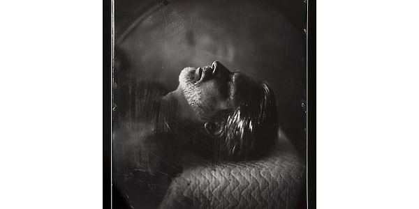 Proud Flesh, 2009. This photograph gives a rather ominous vibe and this is achieved due to the way in which it is lit and how the contrasts come into play. The face is lit from the left side of the frame lighting up his beard, tip of his nose, brow and a part of his hair. His eyes are closed and this area lies in the shadow giving a feeling like he's in is deathbed or already dead.