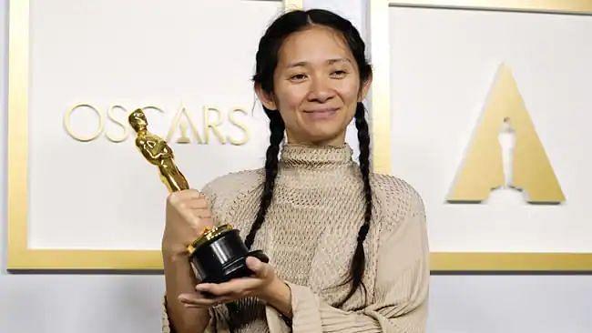 Oscars 21: প্রথম এশীয় বংশোদ্ভূত মহিলা হিসেবে অস্কার জিতলেন ক্লোয়ি ঝাও