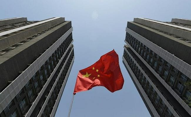 कम होती विकास की रफ्तार और कर्ज में हो रहे इजाफे से मूडीज ने घटायी चीन की रेटिंग