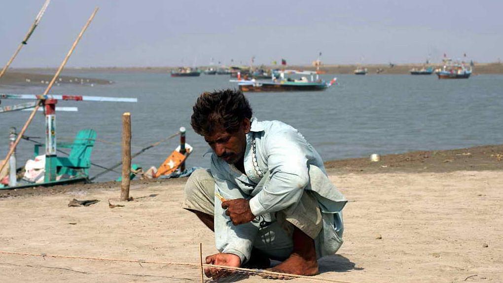 پاکستان: سندھو ڈیلٹا پر اڑتی ریت پھانکتے لوگوں کا درد