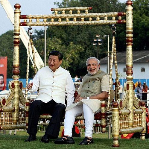 17 ستمبر 2014: احمد آباد میں سابرمتی ندی کے ساحل پر وزیر اعظم مودی اور چینی صدر شی جن پنگ (تصویر بذریعہ نوجیون)