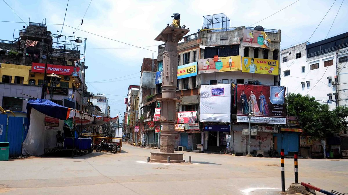 Deserted looks Varanasi market and road during lockdown announced by the State, in Varanasi