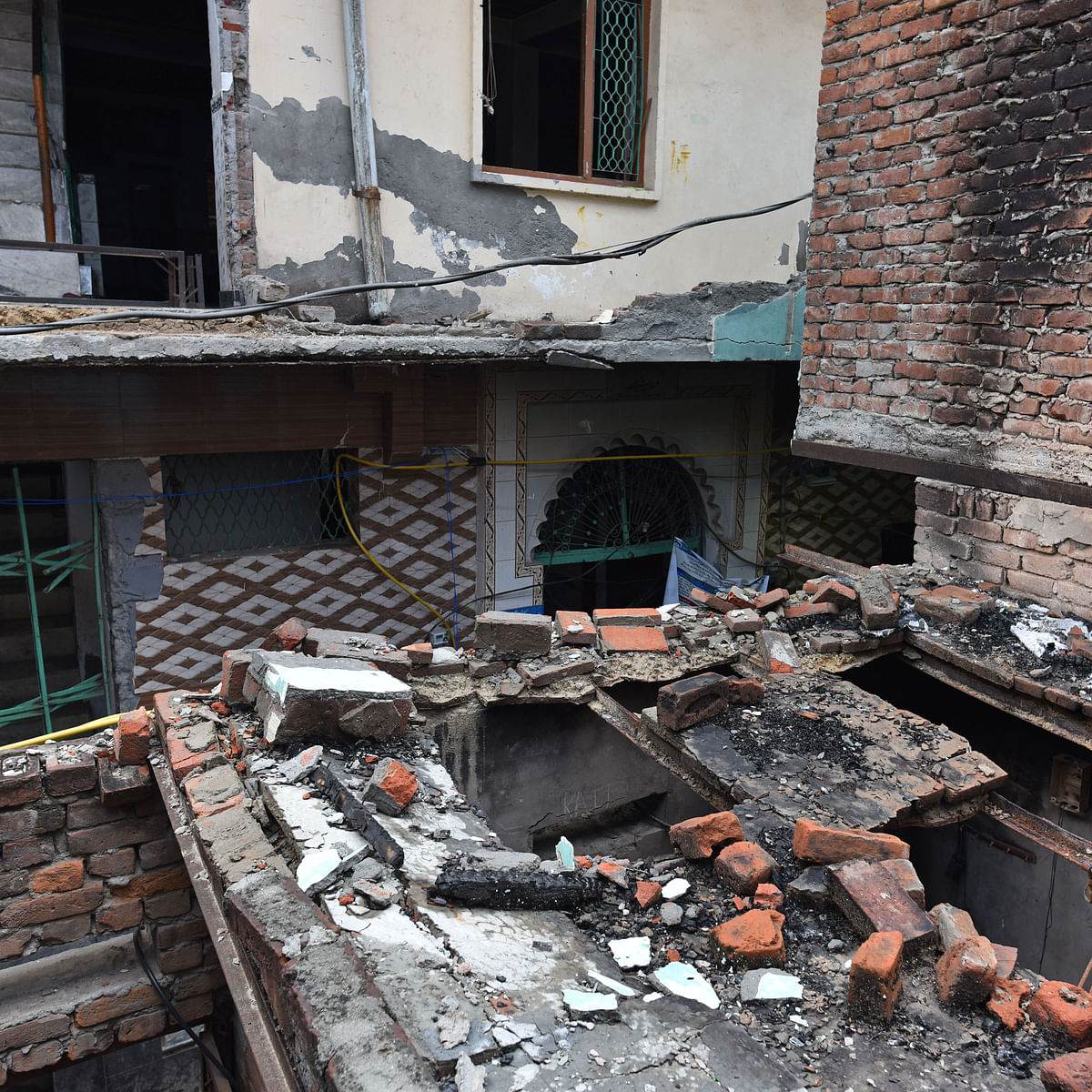 دہلی فسادات کے کے دوران تباہ کئے گئے مکانات / Getty Images