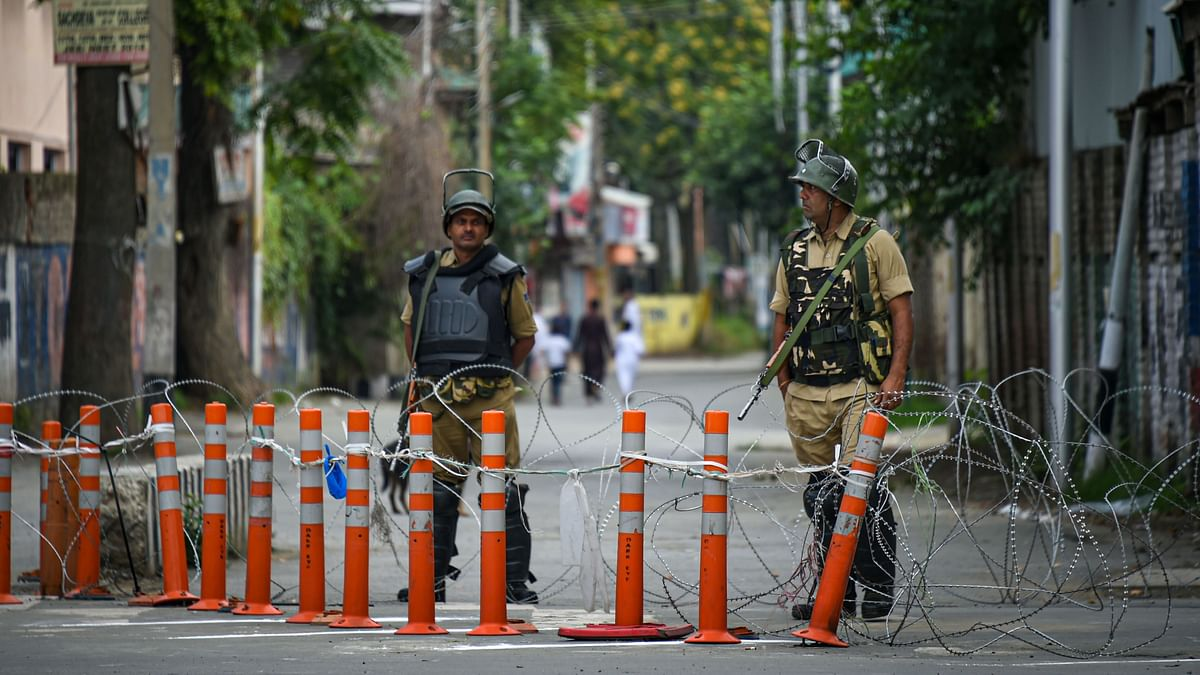 Security personnel stand guard during restrictions, in Srinagar