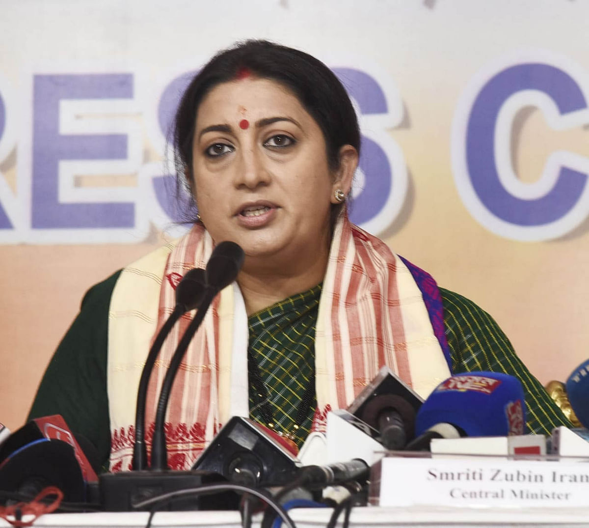 congress-trying-to-save-political-existence-by-holding-hands-of-aiudf--smriti-irani