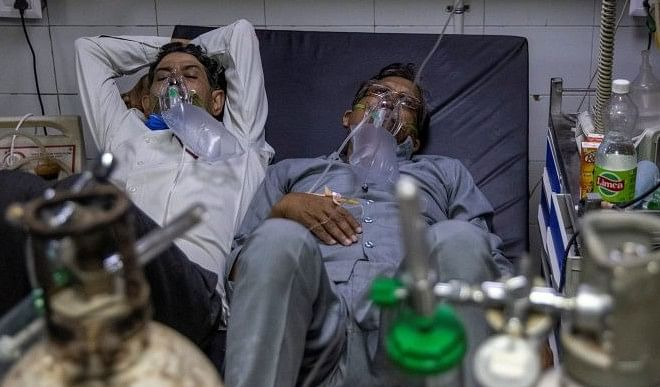 भारत में 63 दिनों बाद 1 लाख से कम कोरोना के मामले, 86,498 नए केस, 2123 लोगों की मौतें