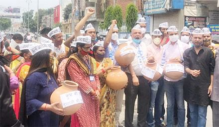 कुंभ कोरोना टेस्ट घोटाला के विरोध में 'आप' का प्रदर्शन