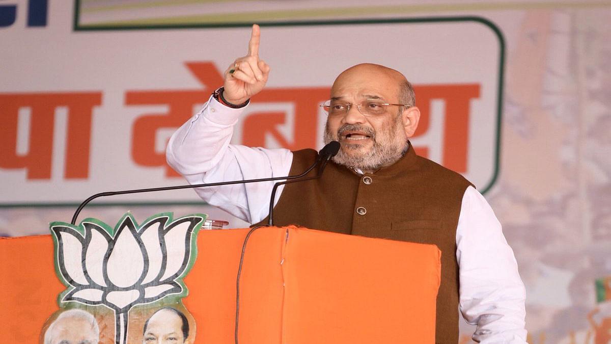 चुनावी रैली को संबोधन करने झारखंड के धनबाद पहुँचे गृह मंत्री अमित शाह।
