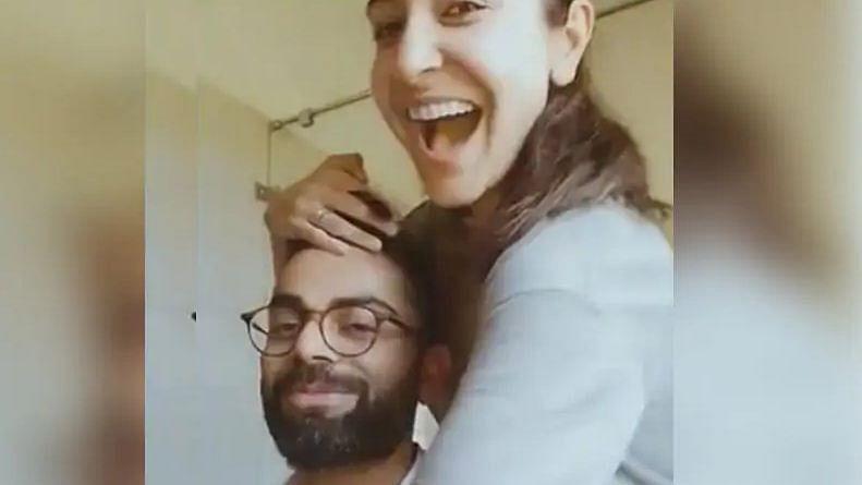 Virat kohli gets a haircut by wife Anushka Sharma