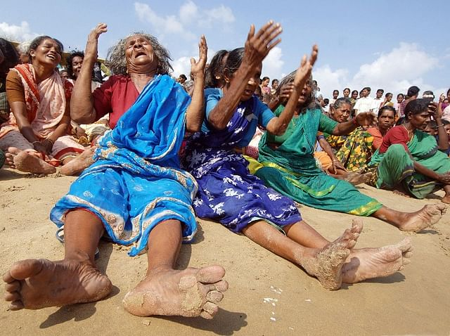 Indian survivors of the December 2004 tsunami burst into tears after they performed a Puja (prayers) for their relatives killed in the tragedy on the beach in Nagapattinam.