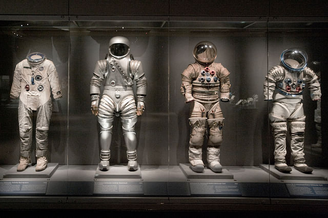 A collection of spacesuits is on display at the Apollo Treasures Gallery at the Kennedy Space Center (Matt Stroshane/Getty Images)