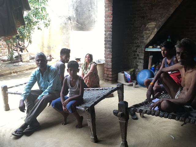 Harswaroop (right) with his family in neighbouring village of Peepli Umarpur.