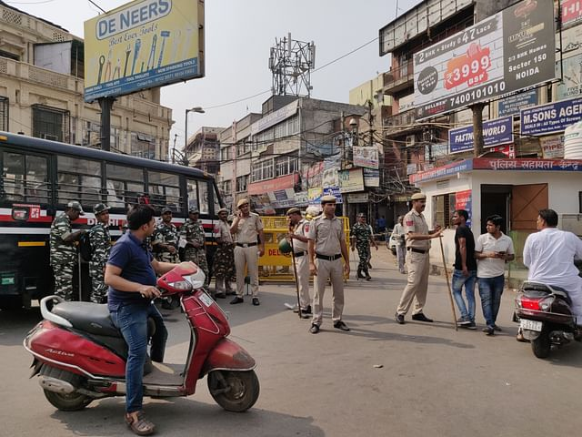 Police and paramilitary personnel at the entrance of Lal Kuan market in Delhi's Chandni Chowk on Tuesday/Swarajya