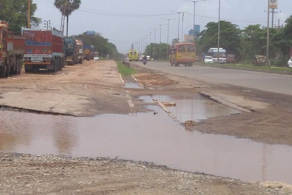 A National Highway in the district ravaged by rain. Note the absence of service roads here as well.