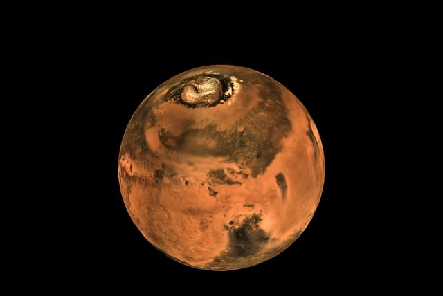 A picture of the red planet in which its northern polar region is visible.  (ISRO)
