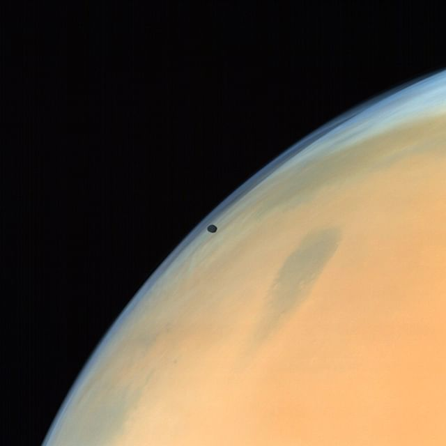 Phobos, one of the two natural satellites of Mars silhouetted against the Martian surface. (ISRO)