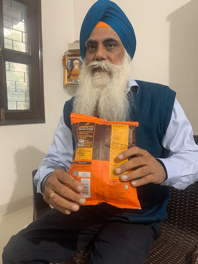 Ravi Ranjan Singh showing <i>halal </i>certified Cornitos chips packet