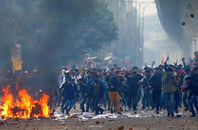 'Stones Pelted, Vehicles Set Ablaze': Anti-CAA Protests Turn Violent In Aligarh, Clash With Police