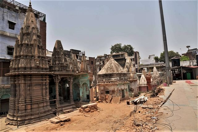 All the structures around the temples that emerged are being cleared and the debris removed