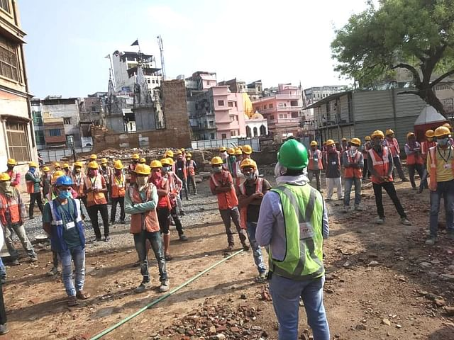 Workers at the Kashi corridor project