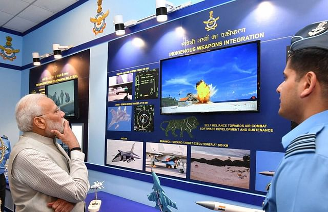 Prime Minister Narendra Modi watching a video of a BrahMos missile impact.