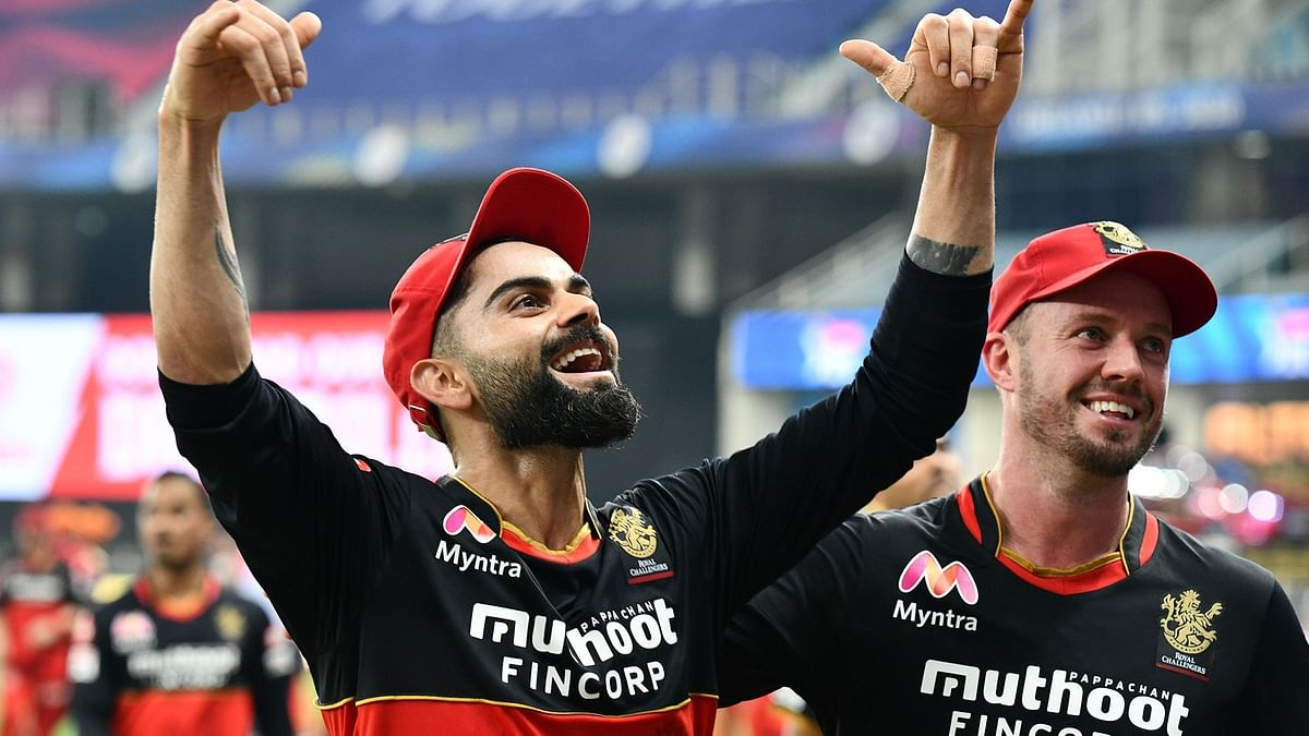 Virat Kohli (left) and AB de Villiers celebrate Royal Challengers Bangalore's (RCB) victory over Sunrisers Hyderabad (SRH) at Dubai on Monday.