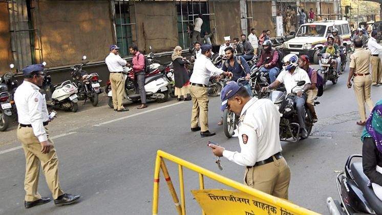Biker violates no-entry rule, threatens traffic cop for stopping him