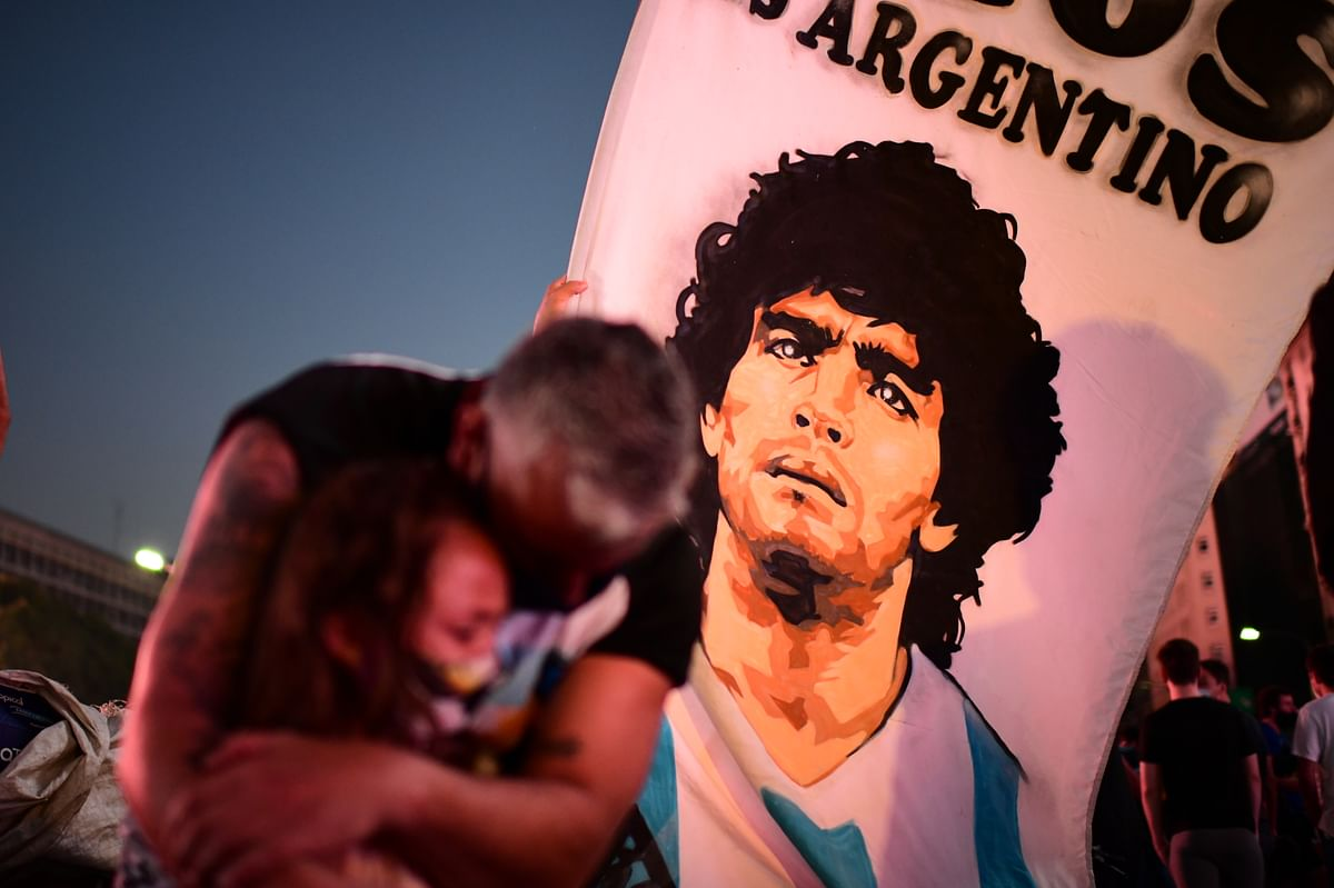 People mourn at the loss of  Argentinian football legend Diego Maradona