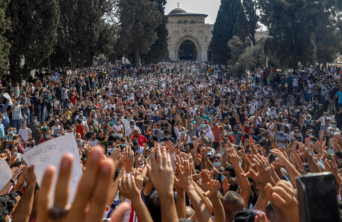 Palestinians gathered to protest against the French president, in the al-Aqsa mosque compound
