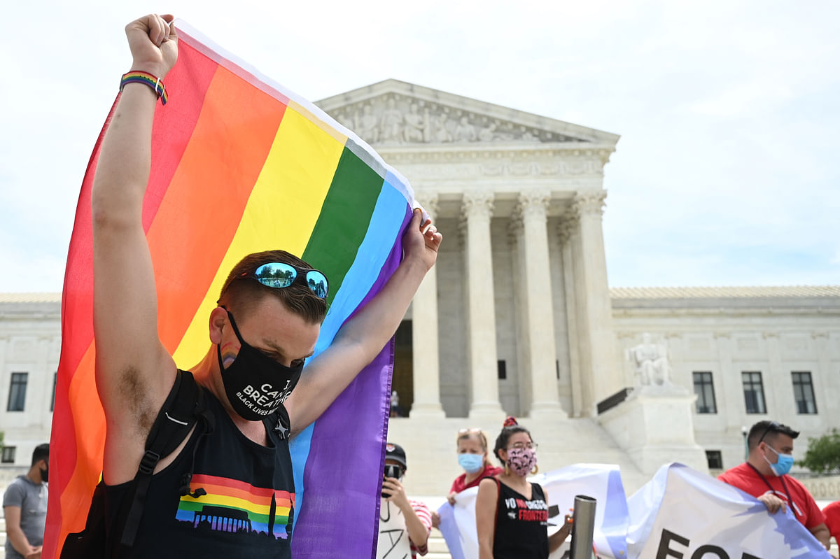 A person celebrates a fedral law that LGBTQ workers from discrimination in Washington,DC