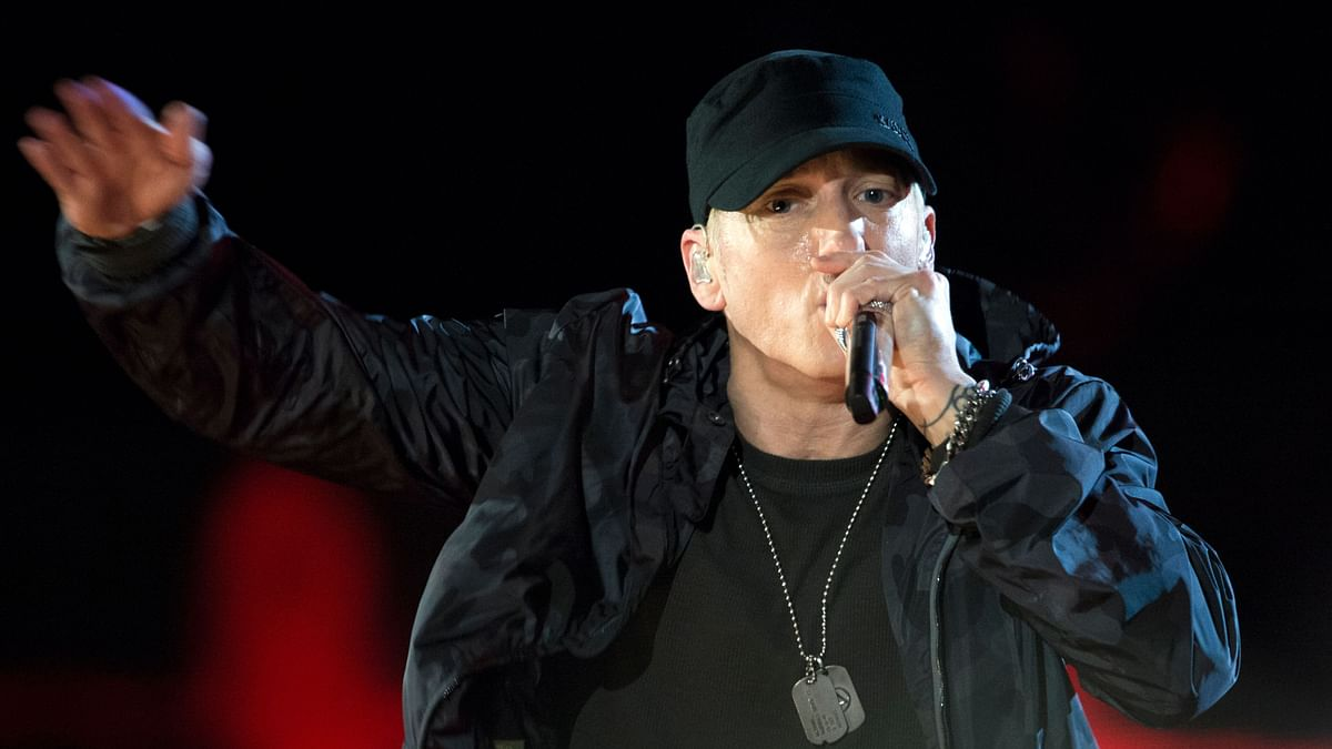 Eminem shared that he and his friends would take turns buying tapes.