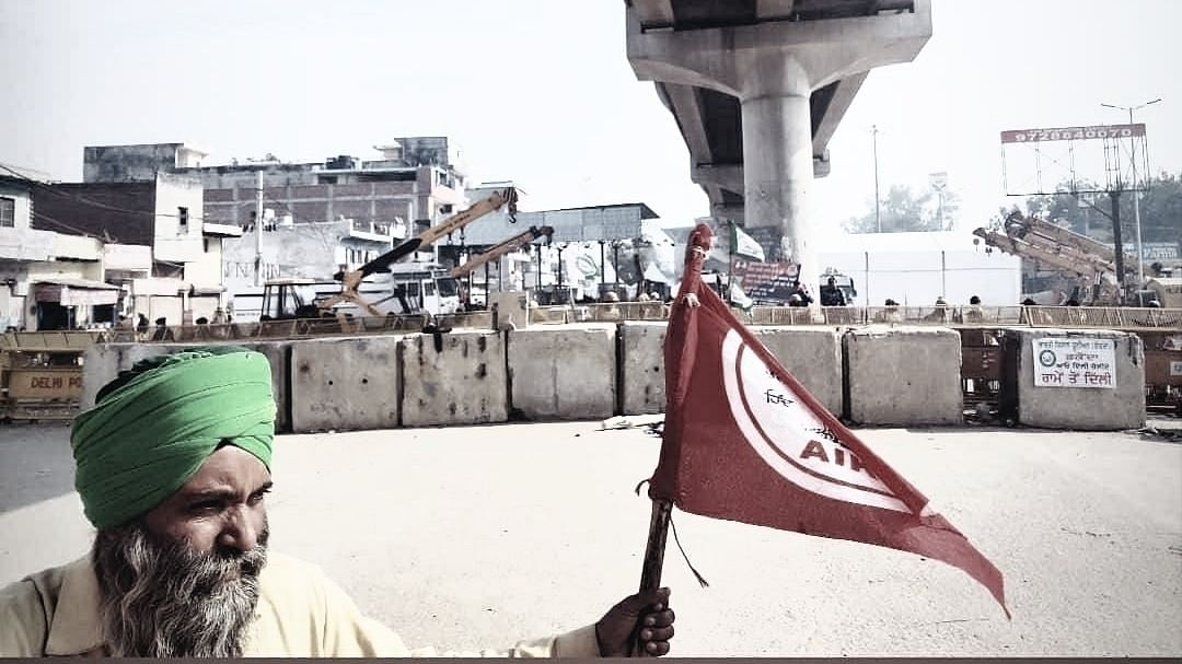A Farmer protesting against new farm laws at Delhi's Tikri border on December 27, 2020
