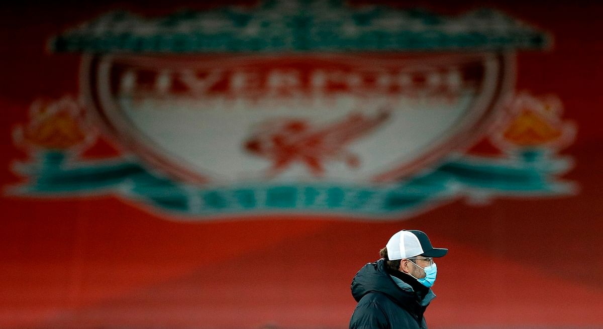 Liverpool's German manager Jurgen Klopp, wearing a face mask or covering due to the COVID-19 pandemic, walks on the pitch ahead of the English Premier League football match between Liverpool and Brighton and Hove Albion at Anfield in Liverpool,