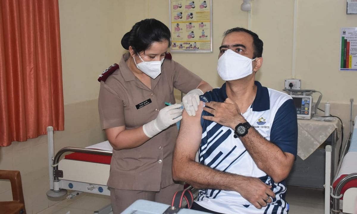 A navy personnel getting vaccinated against COVID-19