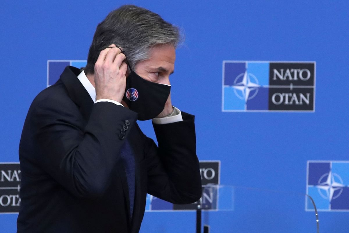 US Secretary of State Antony Blinken puts on his face mask after a debate with NATO Secretary General at a NATO Foreign Ministers' meeting at the Alliance's headquarters in Brussels, Belgium on March 23, 2021