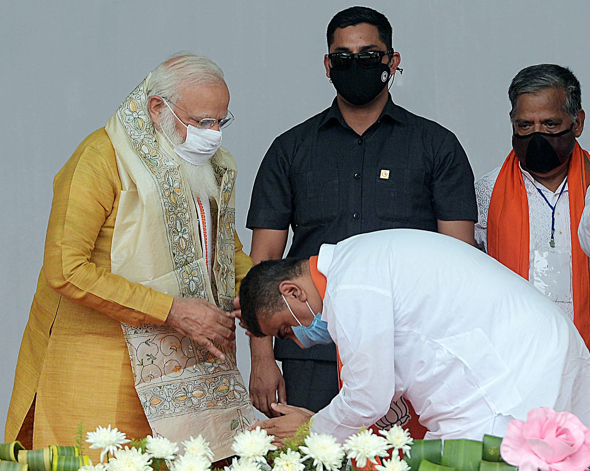 BJP leader Suvendu Adhikari seeks blessings of Prime Minister Narendra Modi during a public rally ahead of assembly elections at Contai in East Midnapore on Wednesday.