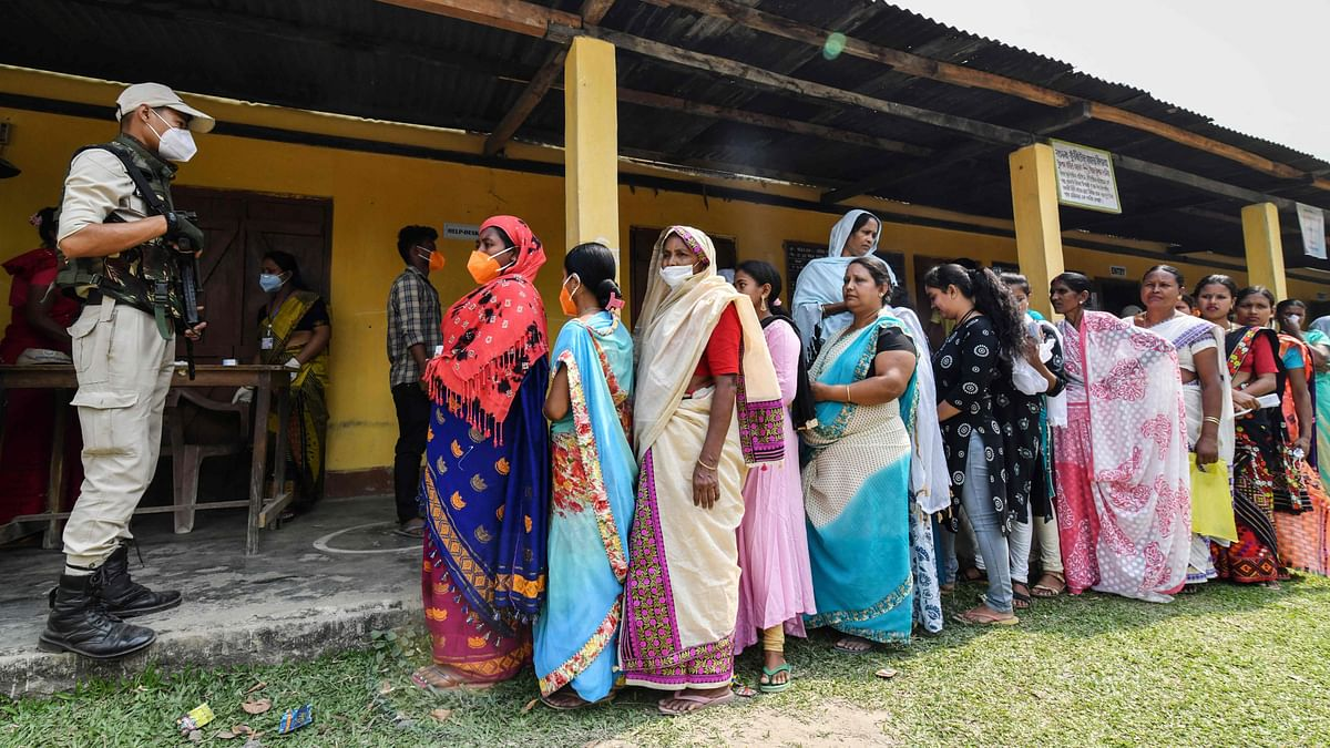 A voter shows her inked finger after casting her vote, outside a polling station during Phase 1 of West Bengal's legislative election in Purulia district on March 27, 2021.