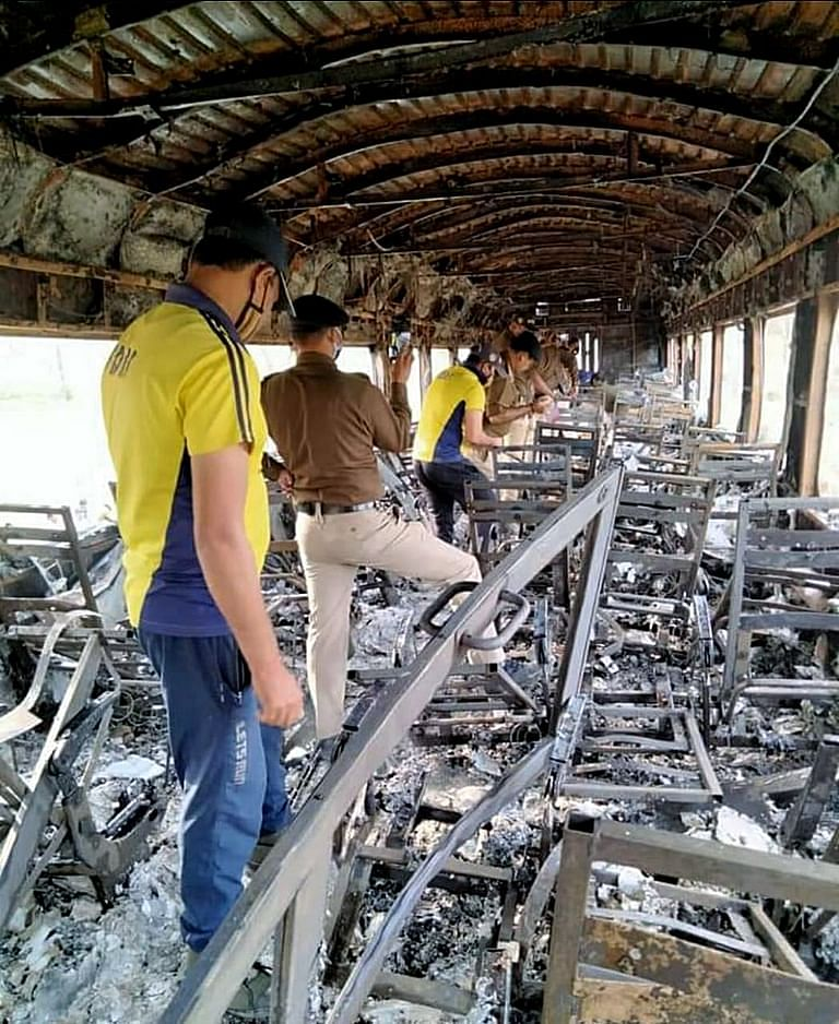 SDRF team inside the burnt compartment of the Delhi-Dehradun Shatabdi Express on Saturday, March 13, 2021. According to the initial probe, the fire was caused due to smoking.