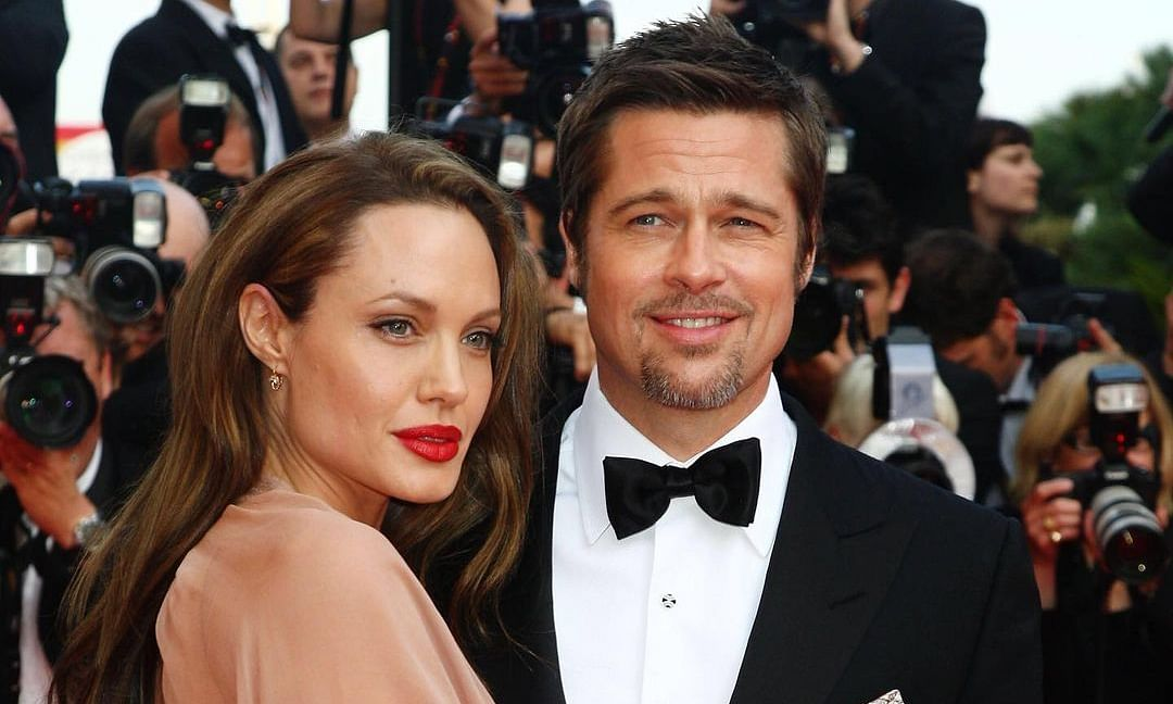 Brad Pitt and Angelina Jolie posing for a picture at the Inglourious Basterds premiere.