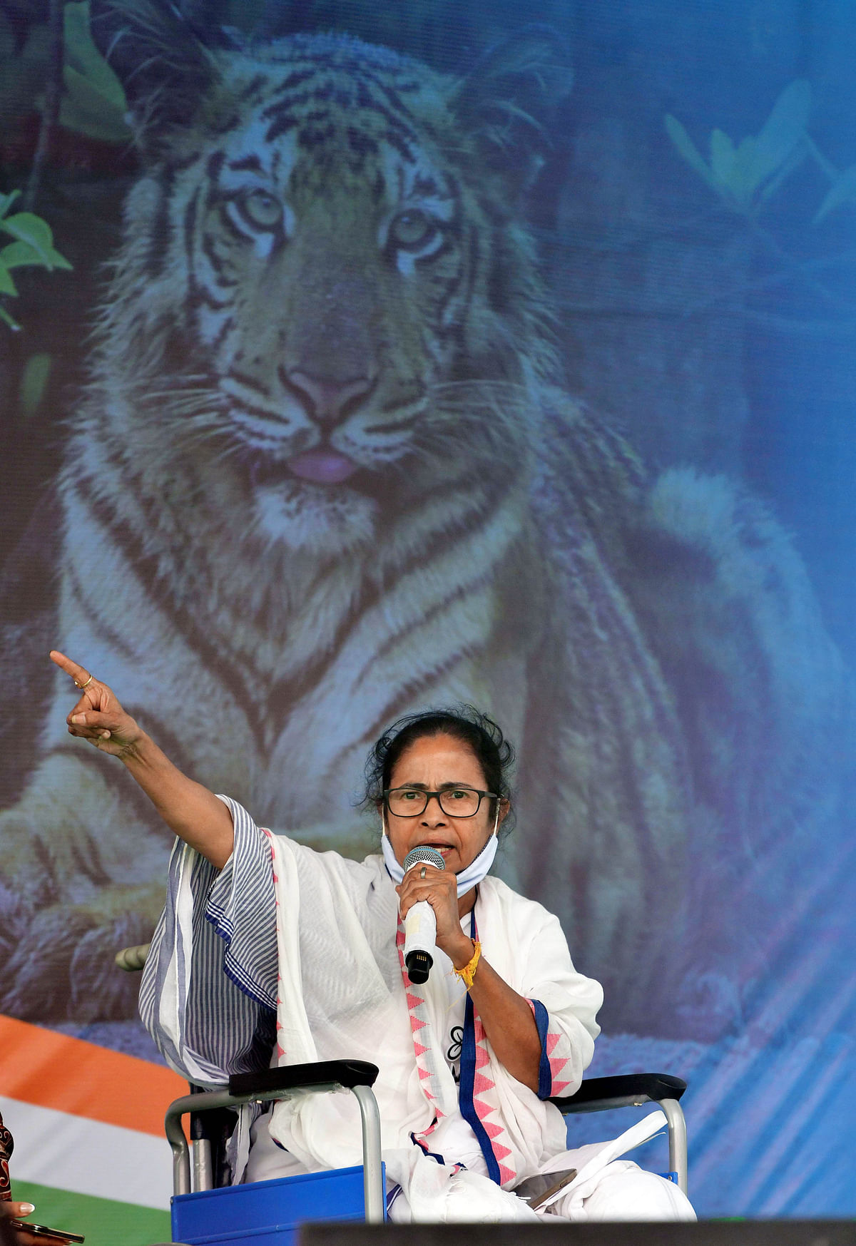 Chief Minister Mamata Banerjee addresses during a public meeting, in Nandigram on Monday.