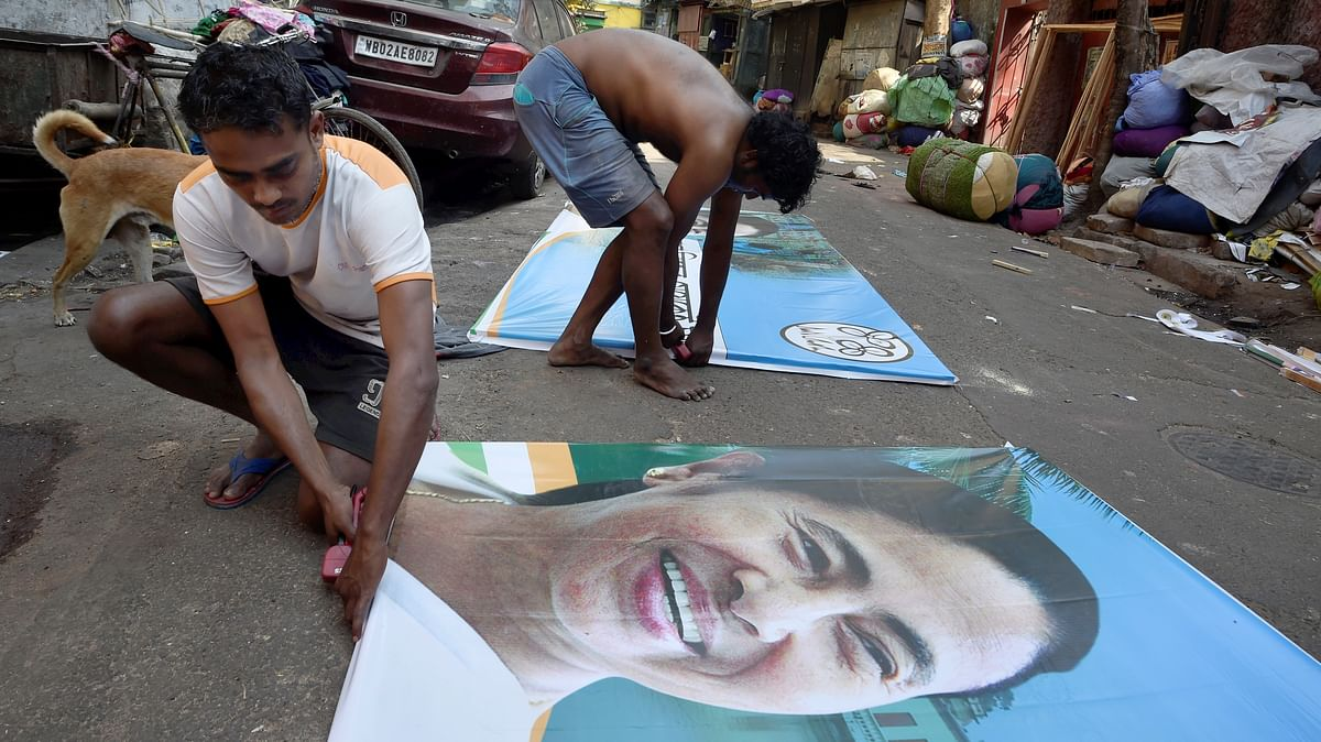 Workers busy in making banners of Trinamool Congress chief Mamata Banerjee ahead of Assembly polls, in Kolkata, Saturday, March 6, 2021.