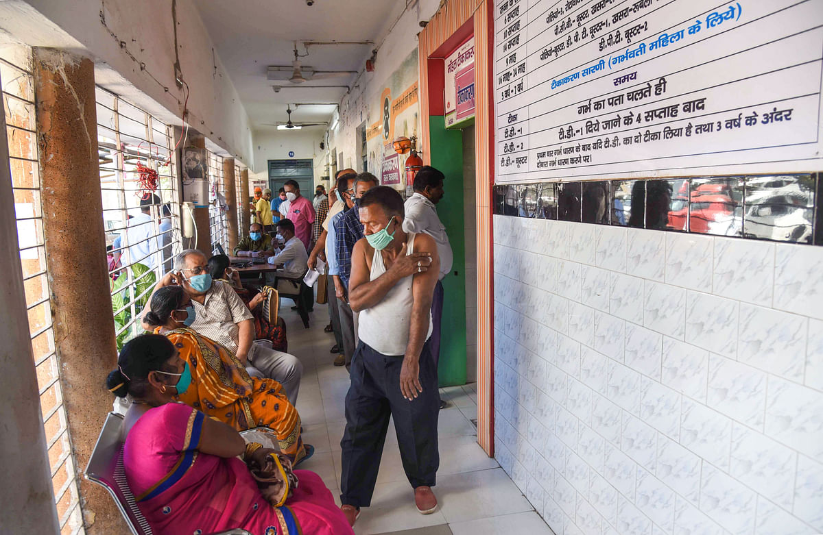 Beneficiaries wait after receiving the first dose of COVID-19 vaccine during the third phase of the countrywide inoculation drive, in Patna, Thursday, April 1, 2021.