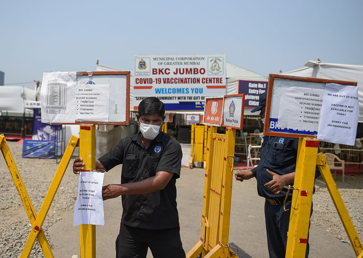 Security  guard closes the barrier outside a Covid-19 coronavirus vaccination centre as vaccination stopped due to shortage of supplies in Mumbai on Wednesday, April 28