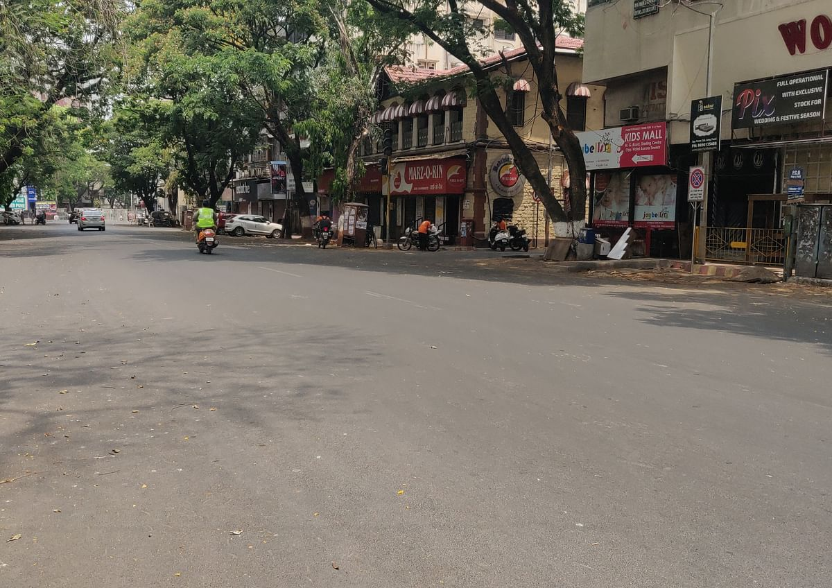 Amid weekend lockdown Pune's MG Road, one of the shopping hubs of the city also wore a deserted look