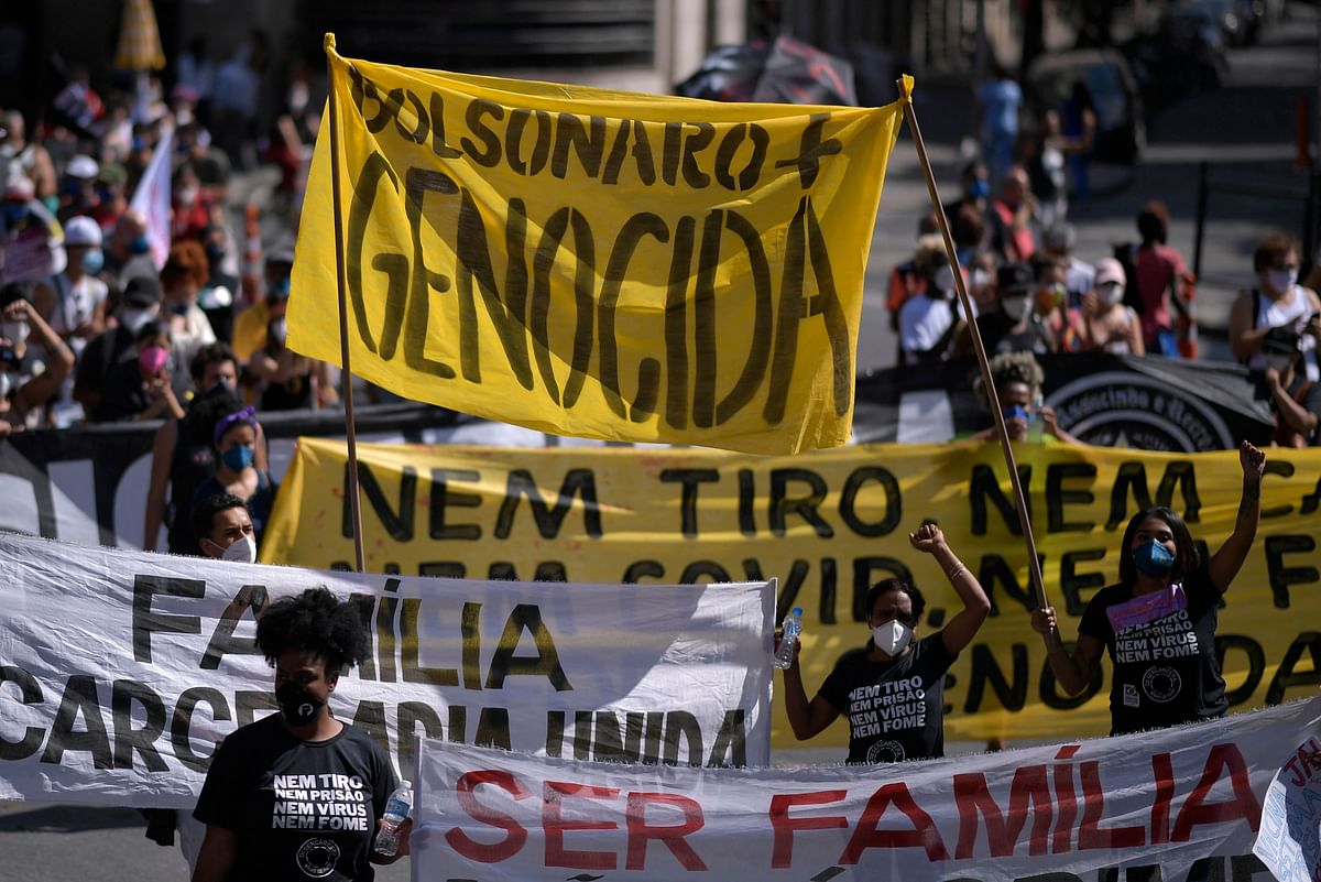 People take part in a protest against Brazilian President Jair Bolsonaro's handling of the COVID-19 pandemic in Belo Horizonte, Brazil on May 29, 2021.