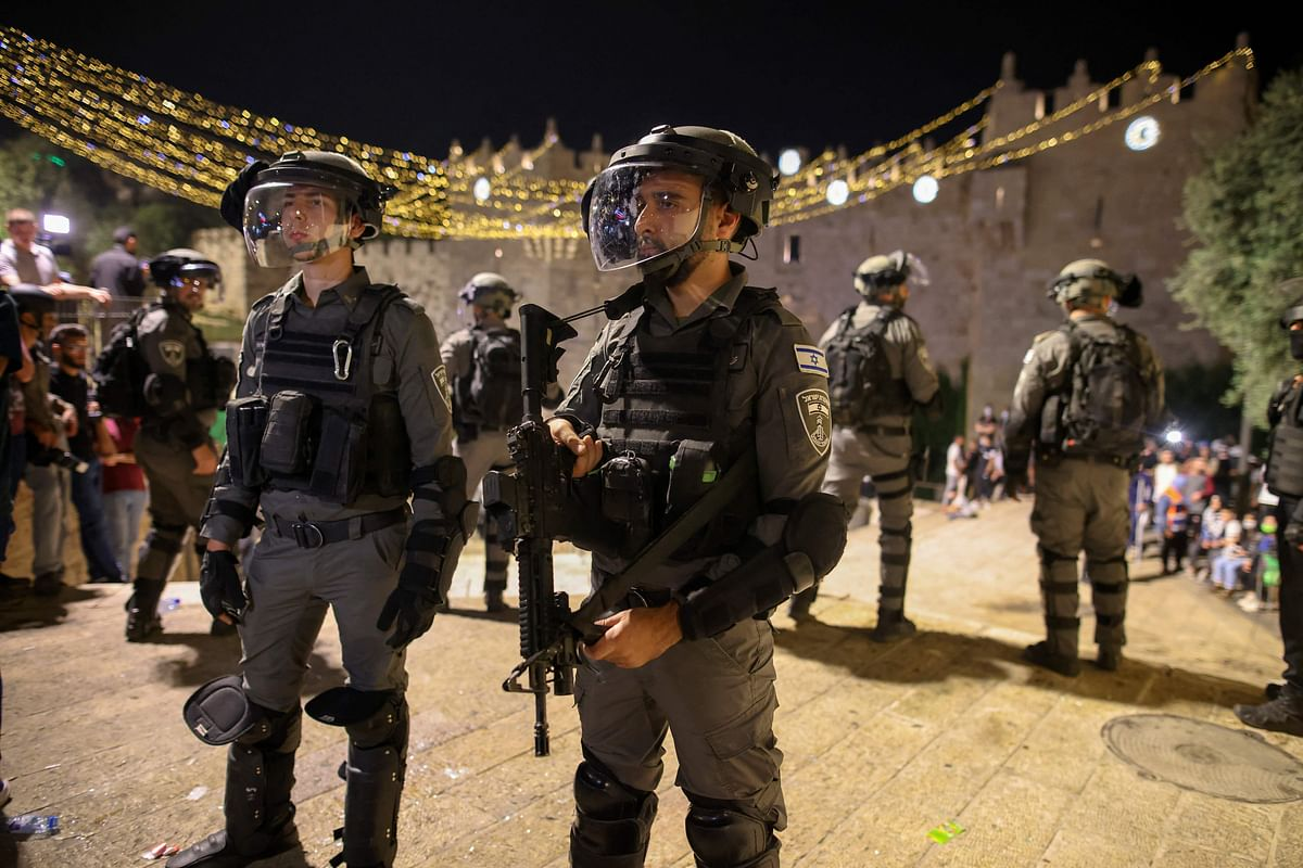 Israeli security forces stand guard during clashes with Palestinian protesters outside the Damascus Gate in Jerusalem's Old City on May 9, 2021.