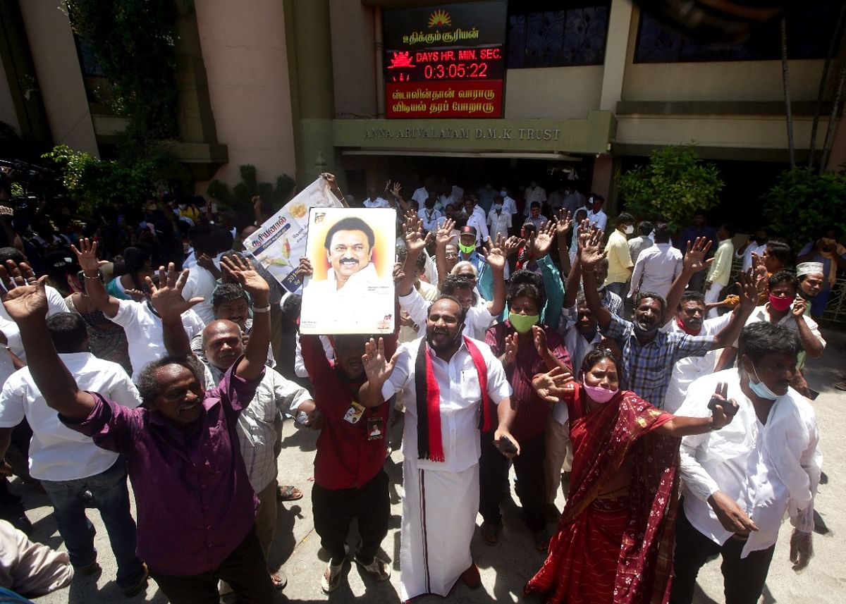 DMK party workers celebrate their party's victory in Tamil Nadu state legislative assembly elections, at party headquarters in Chennai on Sunday.