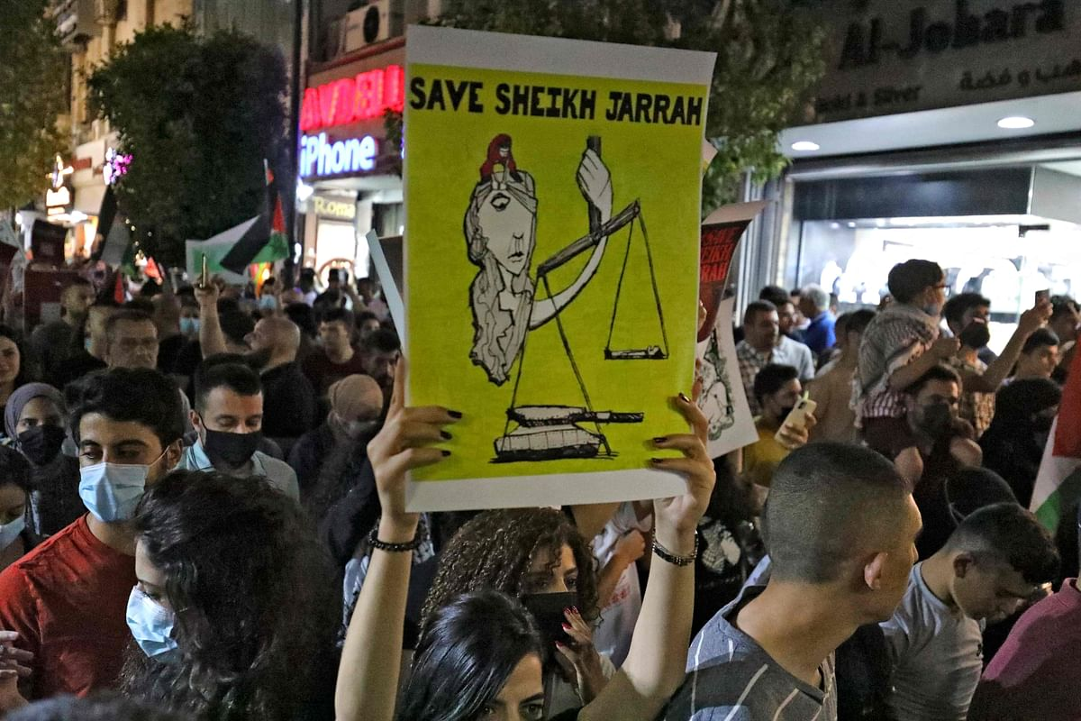 Palestinians protest in the occupied West Bank city of Ramallah on May 9, 2021, in solidarity with Palestinian families facing Israeli eviction orders in the Sheikh Jarrah.