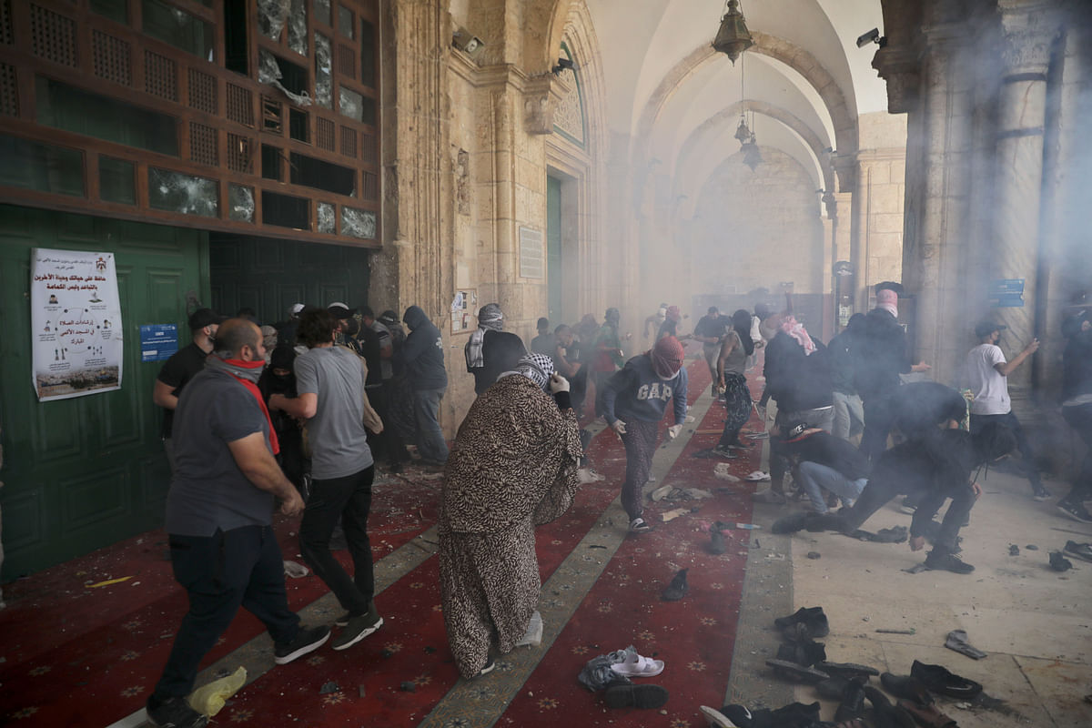 Palestinians clash with Israeli security forces at the Al Aqsa Mosque compound in Jerusalem's Old City Monday, May 10, 2021