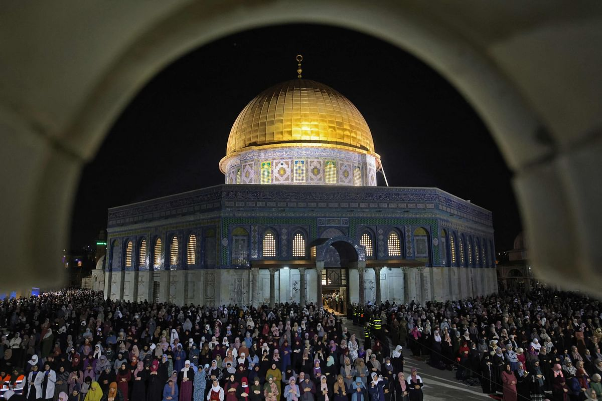 Palestinian devotees pray on Laylat al-Qadr outside the Dome of the Rock in Jerusalem's Al-Aqsa Mosque compound on May 8, 2021.